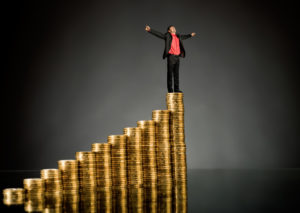http://pas-wordpress-media.s3.amazonaws.com/wp-content/uploads/2013/08/Man-Standing-on-Stack-of-Coins-1024x726.jpg